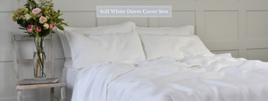 White Linen Duvet Cover on a Bed with Pillowcases