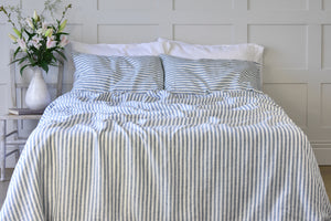 French Blue Ticking Stripe Sheets on a Bed