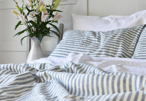Stone Blue Ticking Sheets on a bed