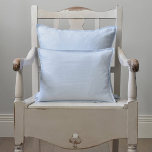 Light Blue Linen Cushion Cover on a Cream Wooden Chair