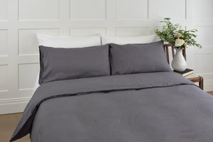White Linen Pillowcase on a Grey French Linen Super King Bed in a Bedroom