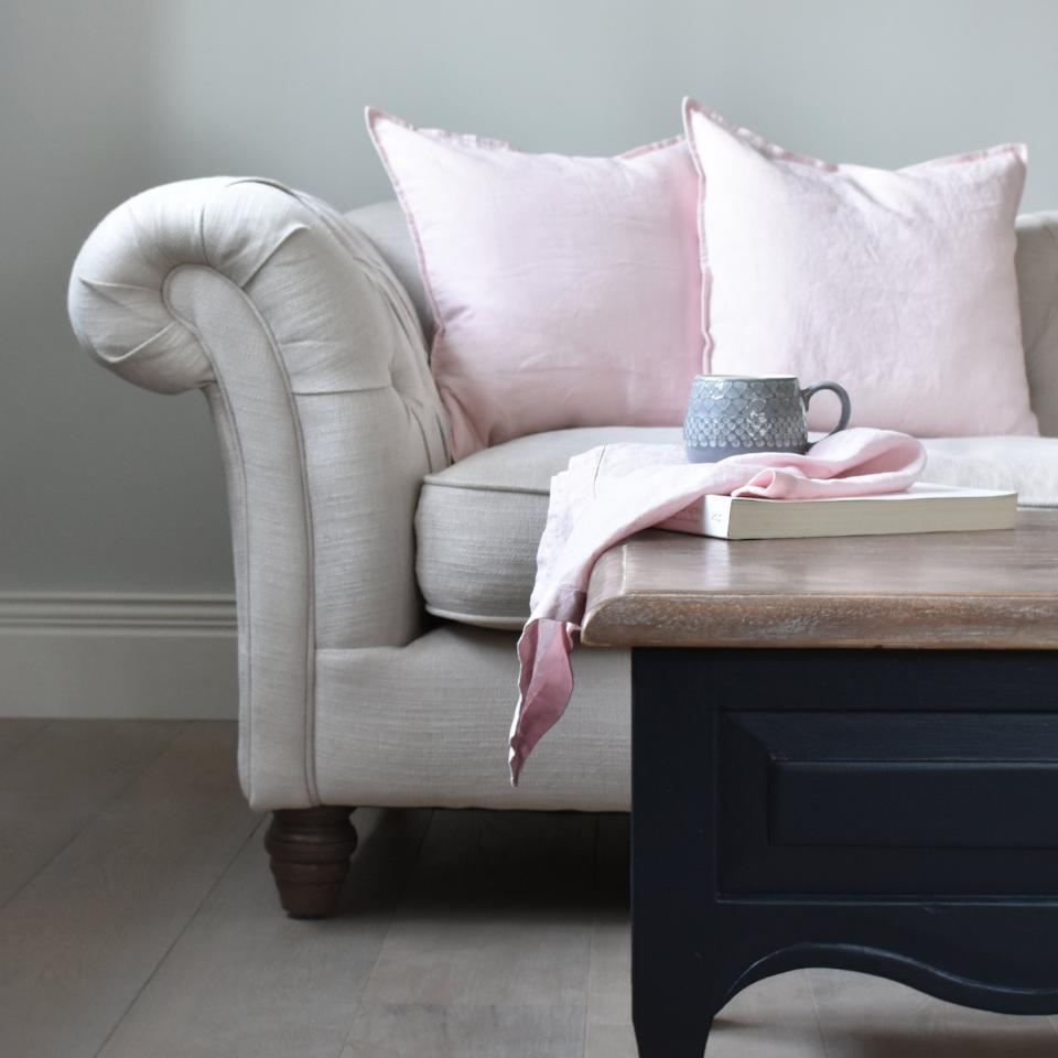 Pink Linen Cushions and Linen Napkins on a Coffee Table