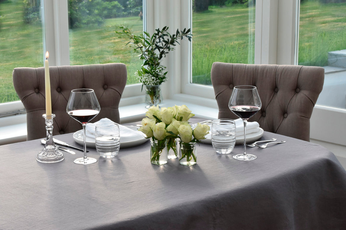Charcoal Grey Linen Tablecloth on a Dining Table with food