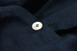 Dark Blue Bedding with a Pearl Button