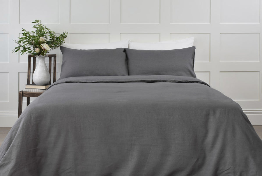 Dark Grey Linen Duvet Cover with a White Sheet tied in a Bundle