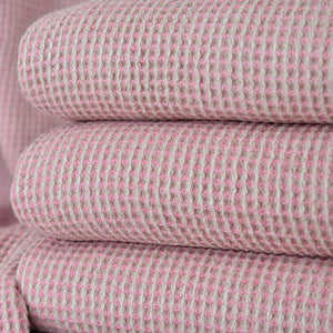 Pink Linen Throws Folded on a chair