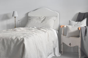 Kids Stripey Bed Linen with a Cream Wooden Chair