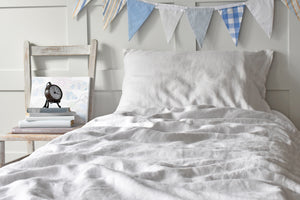 Bed with Kids Grey Linen Duvet Cover and Seaside Bunting