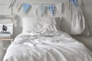 Soft Grey Linen Kids Single Duvet Set on a Bed with Bunting