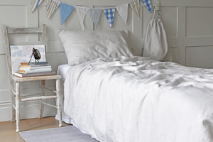 Kids Bedroom with Grey Linen Bedding and a Wooden Chair