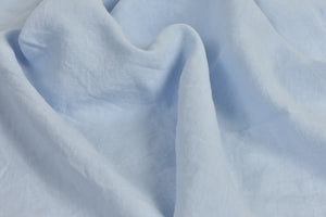 Baby Blue Linen Sheet on a Bed UK
