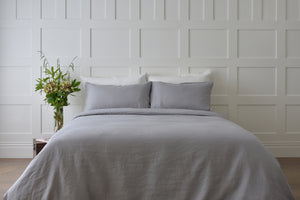 Dove Grey Linen Duvet Cover with a White Sheet in a Bedroom UK