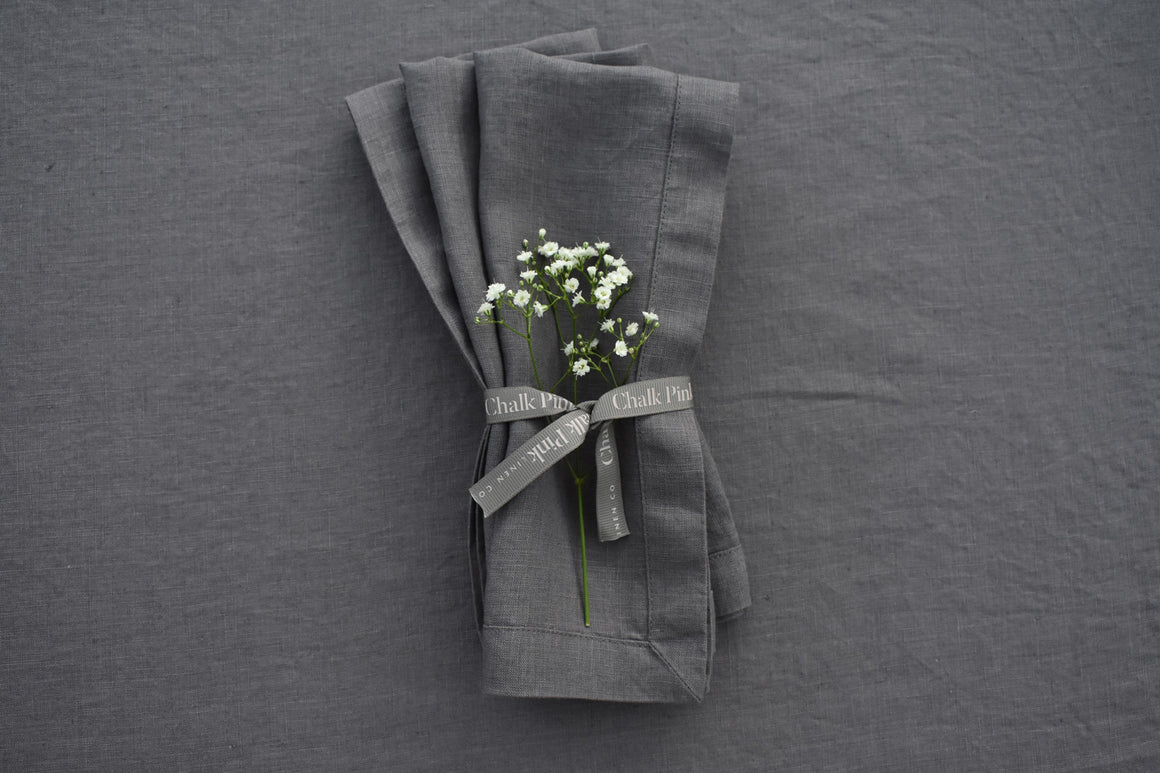 Charcoal Secret Grey Linen Napkins with ribbon tied around