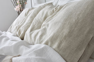Natural Linen Pillowcase on a Bed with White Sheets