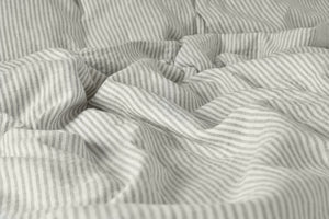 Stripe Ticking Bed Sheet on a Bed
