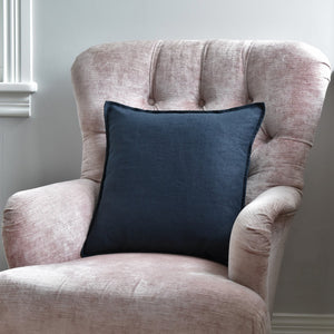 Dark Navy Linen Cushion On A Pink Chair