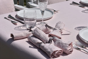 Chalk Pink Linen Napkin on a White Plate in the Garden