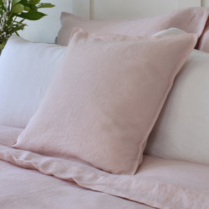 Pink Linen Cushion on Pink and White Bedding