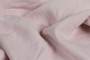 Washed Blush Pink Linen Sheet on a Bed