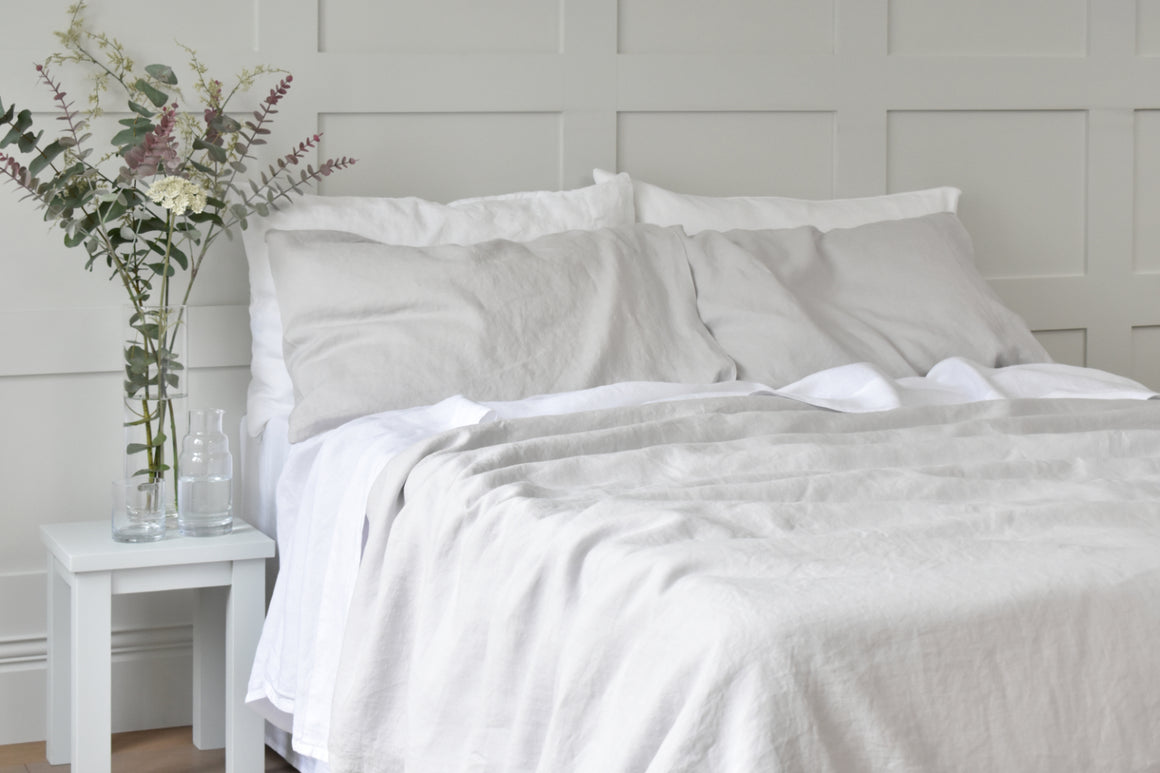 Silver Grey Linen Bedding on a bed with white sheets