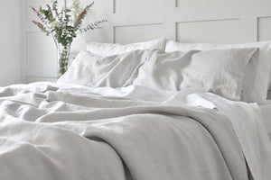 Silver Grey Bed Linen on a bed with white sheets