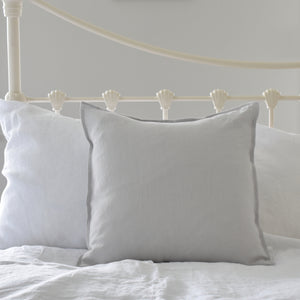 Light Grey Linen Cushion Cover on a White Iron Bed