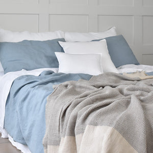 Stone Blue Linen Duvet Cover and a Charcoal Blue Linen Throw