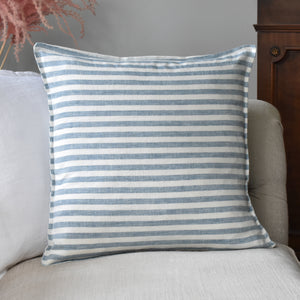 Blue Striped Ticking Linen Cushion Cover On A Sofa