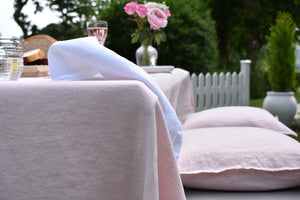 White Linen Napkin on a Pink Linen Tablecloth in the Garden