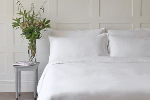 White Linen Duvet Cover on a Bed with a White Sheet UK