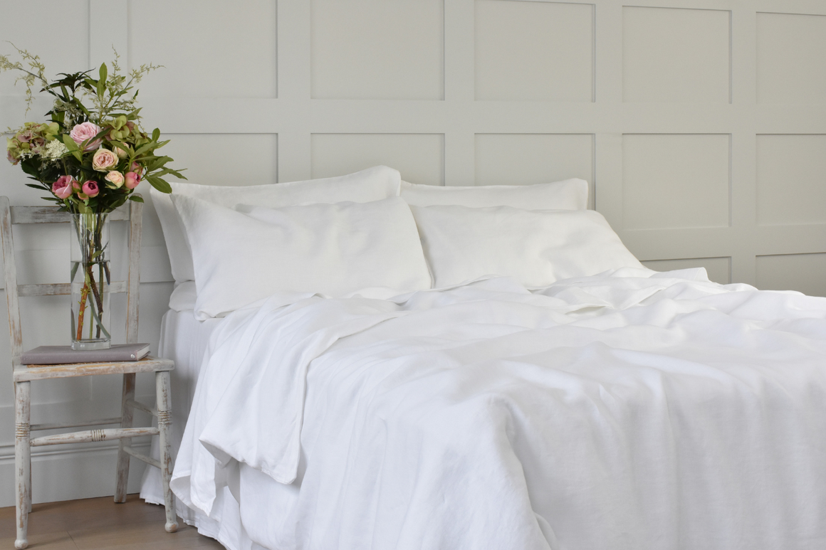 Soft White Pure Linen Quilt Cover with Flowers at the Side of the Bed