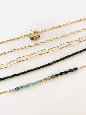 GREEN TOURMALINE AND CHAIN BRACELETS