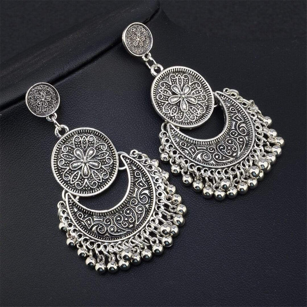 Bohemian   ethnic wind carved ball tassel earrings