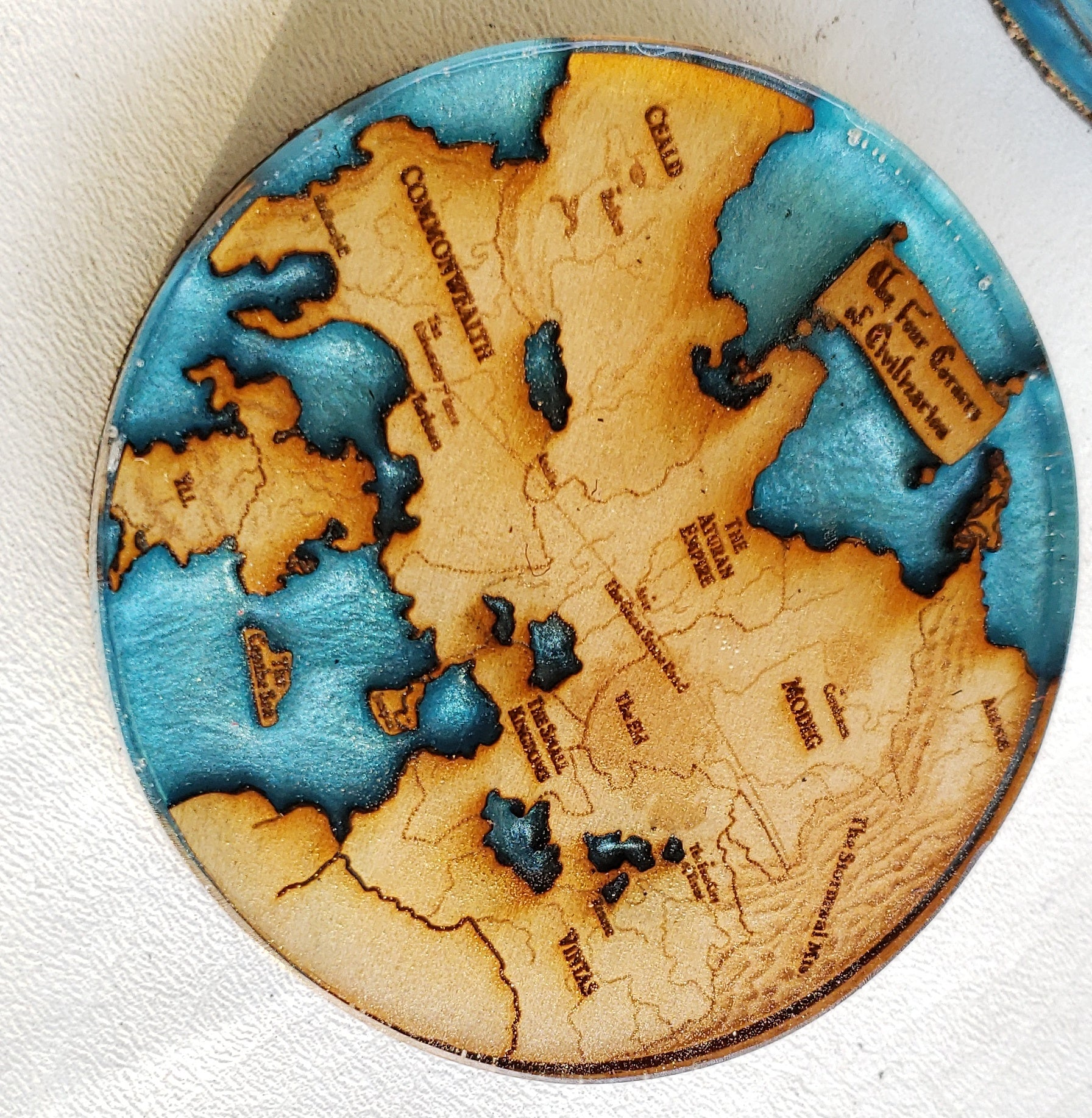 Fantasy Map Coasters- Set of Five – Heathen Boutique on the riyria chronicles map, unicorn chronicles luster of a map, powder mage trilogy map, terry pratchett discworld map, jim butcher codex alera map,