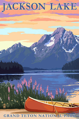 Beautiful nature scene of Jackson Lake in Grand Teton National Park, Wyoming, with a canoe and spring flowers in foreground, Jackson Lake in the middle ground, and Tetons in the background