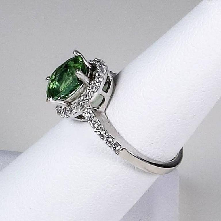 Gemjunky Glowing Oval Green Tourmaline Halo Set in Sterling Silver Ring