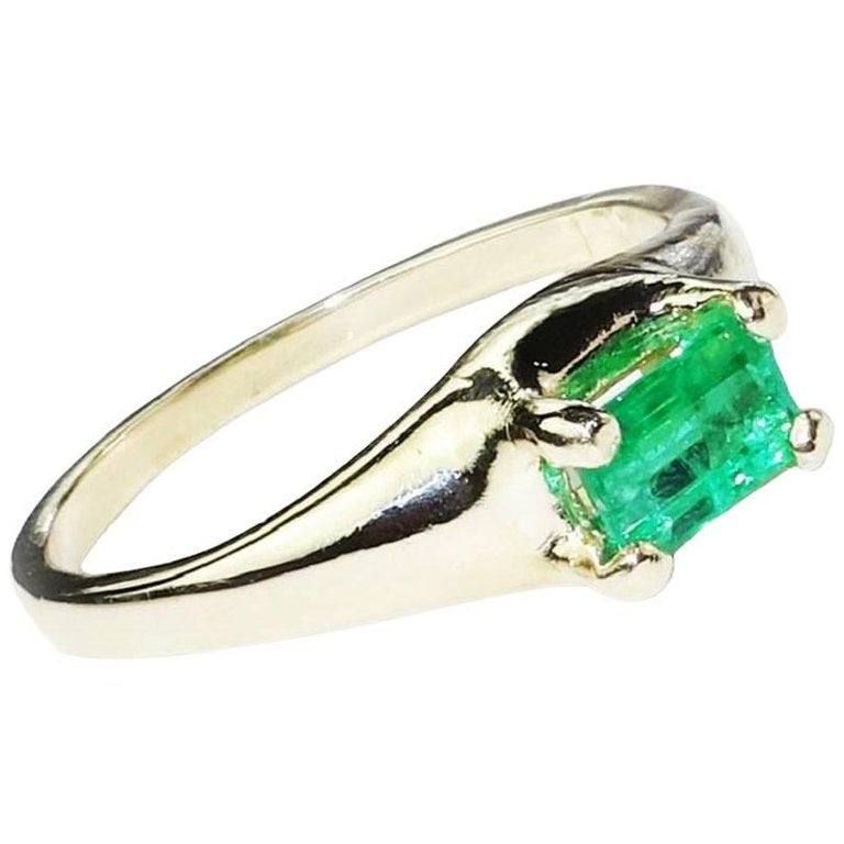 Brazilian Emerald Cut Emerald in Yellow Gold Ring