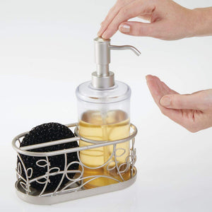 On amazon mdesign decorative wire kitchen sink countertop pump bottle caddy liquid hand soap dispenser with storage compartment holds and stores sponges scrubbers and brushes vine design clear satin