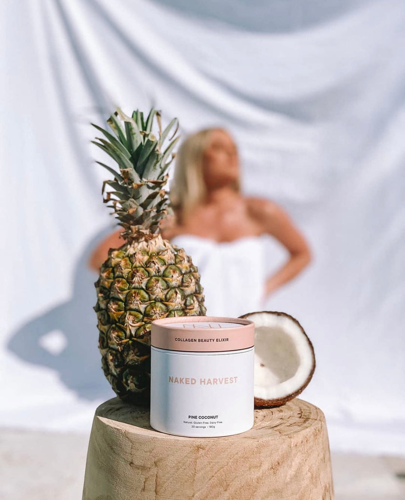 Naked Harvest Collagen Beauty Elixir with pineapple and coconut and Georgie Stevenson blurred in the background