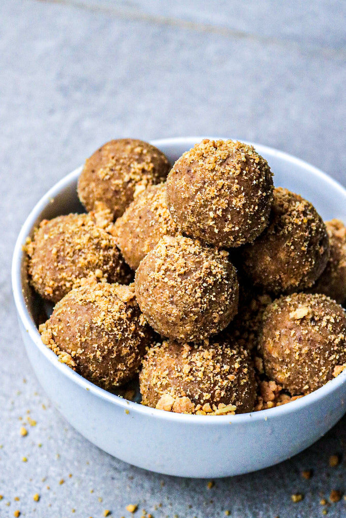 Vanilla protein bliss balls covered in scotch finger biscuit dust