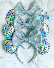 Holographic geometric Ears