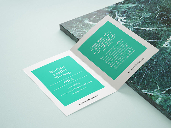 creative mockup of bi fold leaflet brochure with marble rock panel