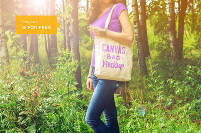 Woman Holding a Canvas Bag PSD Mockup