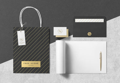 PSD Stationery Scene Mockup with Paper Bag and Pen