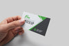 Hand Holding Realistic Business Card PSD Mockup