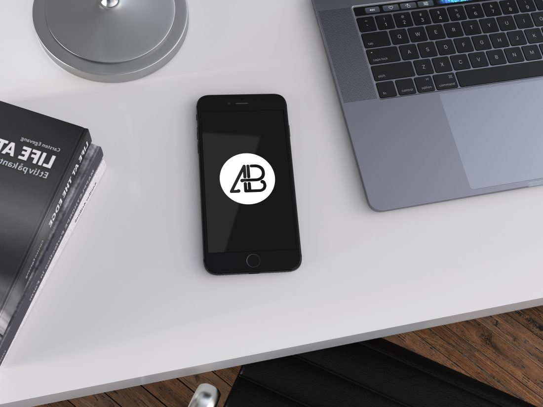 Realistic Jet Black Iphone 7 Plus Mockup On Office Table Top View