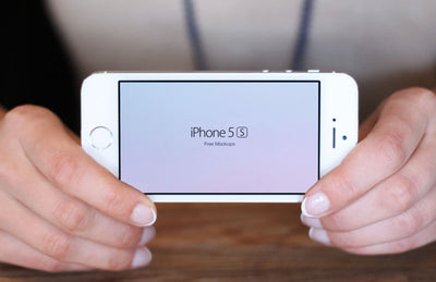 Set of iPhone 5S In Hand (Mockup)