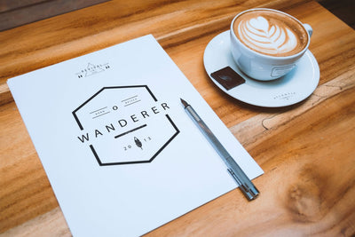 A4 Letterhead and Coffee Cup on Table (Mockup)