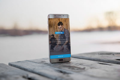 Android Smart Phone Mockup on a Wooden Table Outdoors