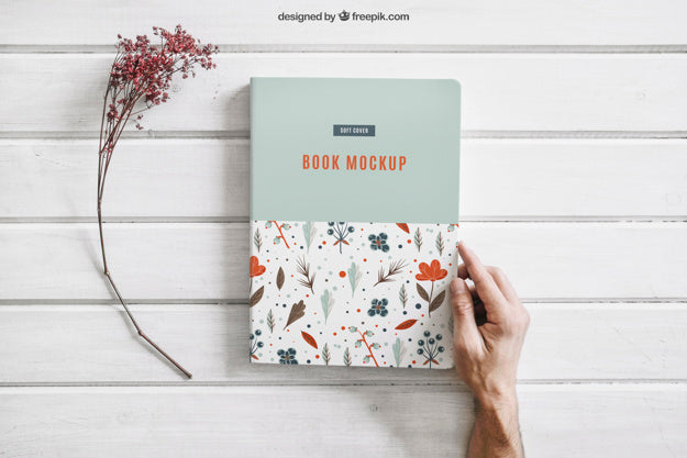 Book Mockup With A Flower And Hand Mockup Hunt